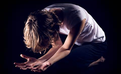 Deep Surrender to God: Woman Kneeling in Prayer
