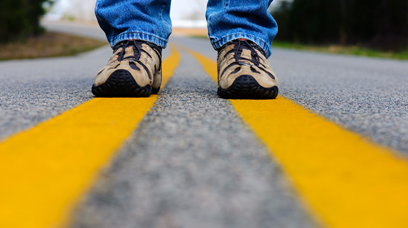 Values and Guidelines : Man's Feet on Yellow Highway Lines